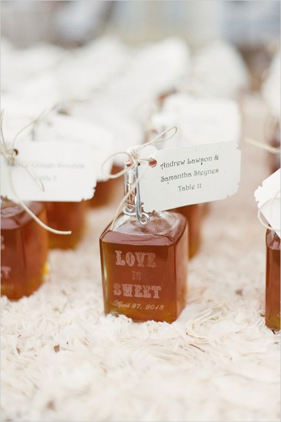 Love is sweet honey favors and escort cards. Event Design: The Simplifiers http://www.weddingchicks.com/2014/05/29/vintage-reception-with-steal-worthy-ideas/