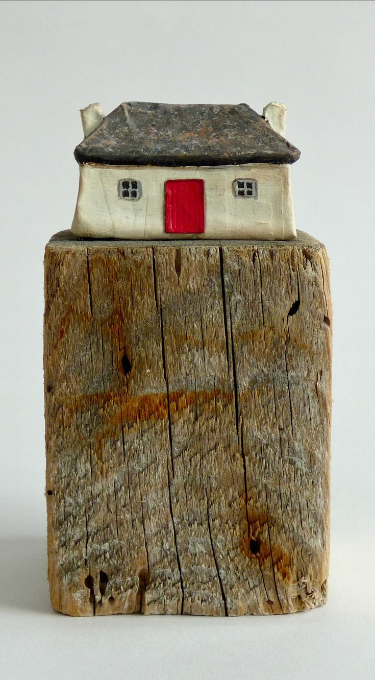 Joanna Caskie paper mache and driftwood sculpture.  Little Crofter's Cottage with a thatched roof.