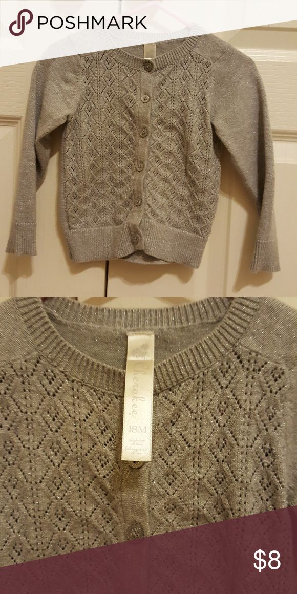 🎀 Silver cardigan and gold crop cardigan 🎀 This Cherokee lovely silver cardigan with super cute silver buttons! The other is a gold sparkly cropped cardigan from Carter's.  Perfect for any outfit! Willing to separate,  just let me know. :) Cherokee Shirts & Tops Sweaters
