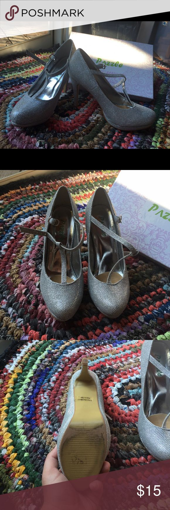 Silver Strappy Heels Perfect for homecoming, prom, and weddings! Cute silver heels with T-strap around ankle. Like new condition, only worn once! Still in box, also has extra pieces for the heel (I can post pictures upon request). Insole is removable, never used, but added to make shoes more comfortable. Pazzle Shoes Heels