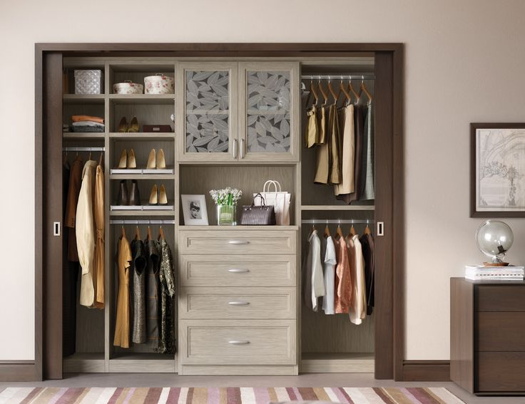 Complete with chic sliding doors, this reach-in closet reveals an elegant storage solution that maximizes space.