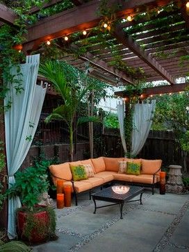 "Patio cover, outdoor curtains, string lighting. Fast growing long flowering Red Trumpet Vine on patio cover. Heaters 240 watts, run on backside and top of beams. Target 120 watt tivoil lights 20' per strand. White pipe on main beam above heater is mist system. Hung the curtains on an 1/8"" steel cable connected to each post."