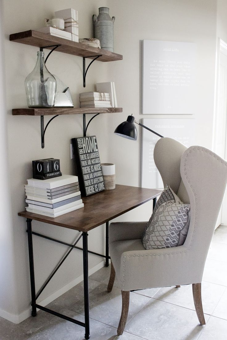 Home decorating ideas - small home office desk in rustic industrial glam style. Wingback chair, simple wood and metal frame desk, wood shelves with black metal brackets | A House and A Dog