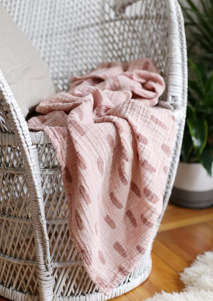 close up of pink muslin blanket on white chair in 2020