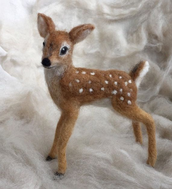 This sweet deer fawn is inspired by the wildlife I see in my backyard. A white-tailed deer, like Bambi. This fawn is poseable, even the tail can be posed to simulate a white-tailed deer tail which flips up when running.  Like my other needle-felted creations, this fawn is an original. I do not use patterns; I use a free form style. Although I may create this fawn multiple times, no two will be exactly alike, but they will be very similar, like twins. My fawn is created of a variety of wool…