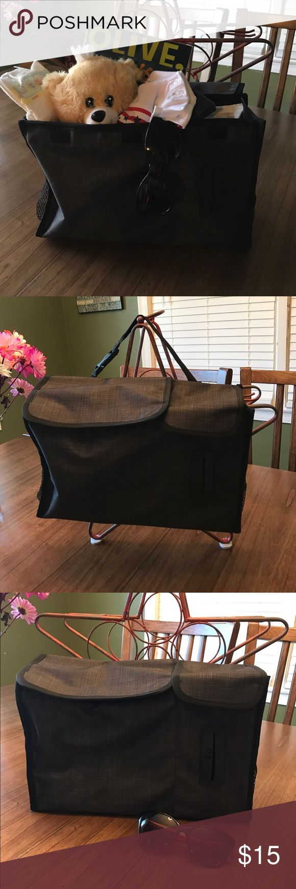 Thirty One storage container, perfect for your car Great to use in your car to keep extras of all those baby items you need on hand. It even has a strap to hang on the seat too!! Love this!! Thirty One Accessories
