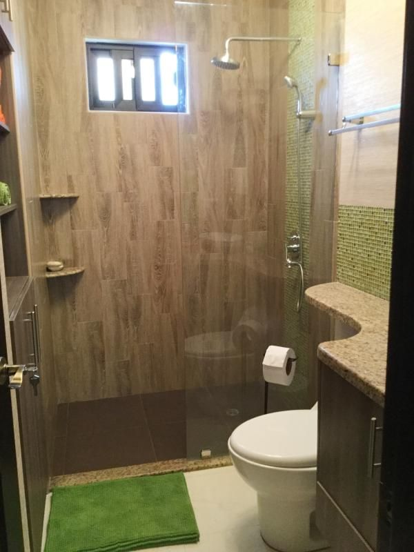 Bathroom with stand up shower.