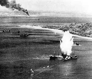 A Japanese freighter in Truk Atoll is hit by a torpedo dropped from a TBF Avenger from USS Enterprise during Operation Hailstone, February 17, 1944.