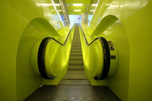 Illuminated Escalator - Seattle Library by anadelmann, via Flickr
