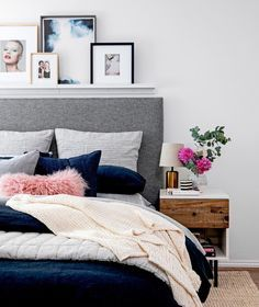 Navy duvet, gray upholstered bed, navy accent wall, light gray other walls                                                                                                                                                     More