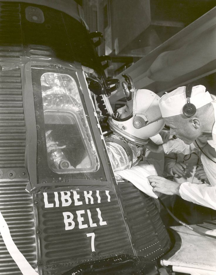 """Astronaut Gus Grissom climbs into ""Liberty Bell 7"" spacecraft before launch on the morning of July 21, 1961. Astronaut John Glenn, Grissom's back up, helps him into the capsule. A problem with the hatch led Grissom's capsule to sink after splashdown. It was salvaged from the Atlantic Ocean in 1999. Grissom's suborbital flight on a Mercury-Redstone rocket was the second manned U.S. spaceflight. Glenn followed him a month later with the first orbital flight by an American. --image credit…"
