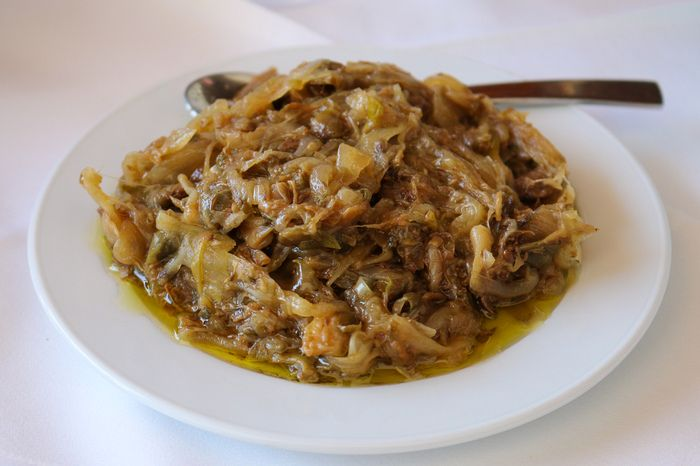"""Dried capers salad"". Dried locally grown capers mashed with caramelised onion, dill and vinegar at Sifnos, Greece."