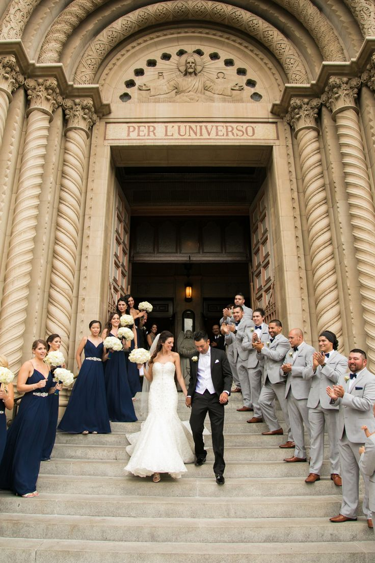 Wedding photo ideas: wedding party lining the steps of the church as the couple walk out as newlyweds. Love! (Ashley Blake Photography)