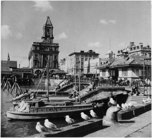 Scene on the Auckland waterfront showing the Ferry Building and waiting rooms - Alexander Turnbull Library