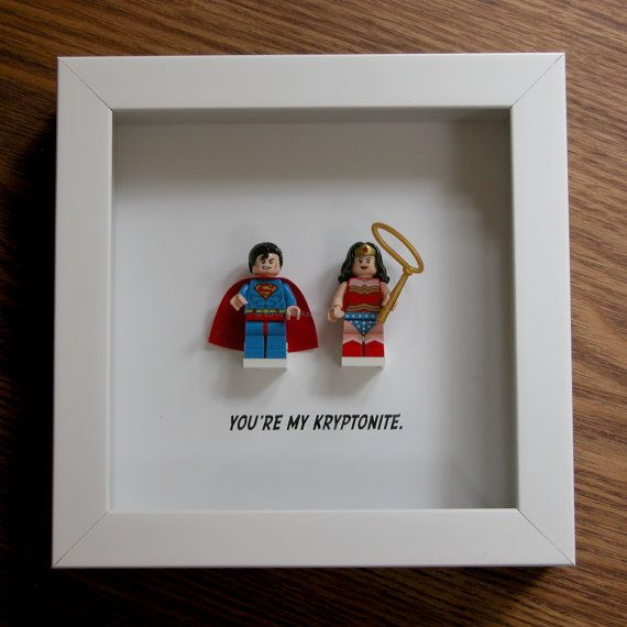 Art frame feature two LEGO® Superhero minifigures, Superman and Wonder Woman with the famous quote: 'You are my kryptonite' beneath. Its the