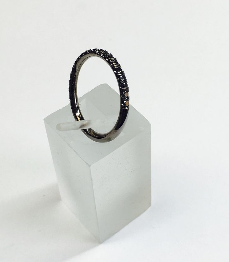 Womens 14k ring with black rhodium. The band is custom made to the finger size. There are 19 natural round brilliant diamonds with color enhanced black (stable using irradiation process). The band measures 2.0mm wide and 1.9mm high. Special orders are available from this ring design.  Model #WB105-BD   The ring comes with a nice leather display box. It takes 5-7 business days before the item ships insured. Someone 18 or over must sign for the package. The pendant has a lifetime warranty…