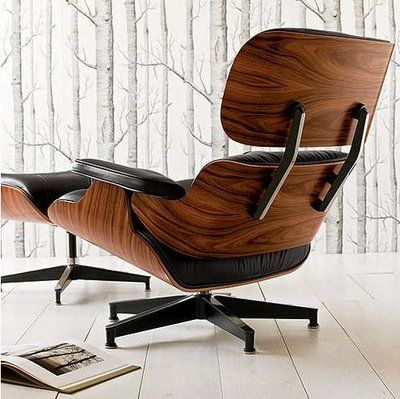 Eames Lounge Chair looks great against the Cole & Son wallpaper   Both available at heals.co.uk