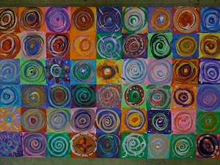 inspired by Kandinsky- each student makes their own circle painting- collage onto large canvas