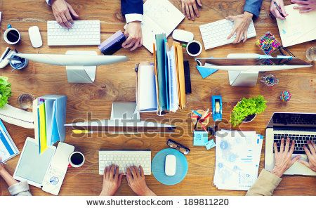 Group of Business People Working on an Office Desk - stock photo