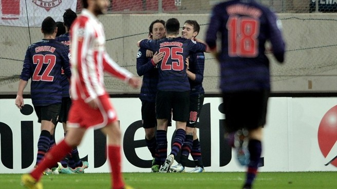 Arsenal FC's players celebrate after scoring against Olympiacos FC during their UEFA Champions League group stage match
