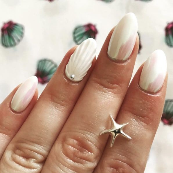 Can T Go Wrong With A Classic White Seashell And Pearl Manicure I Love How Reflective The Pearl Polish Is Pearl Nails Vacation Nails Popular Nails