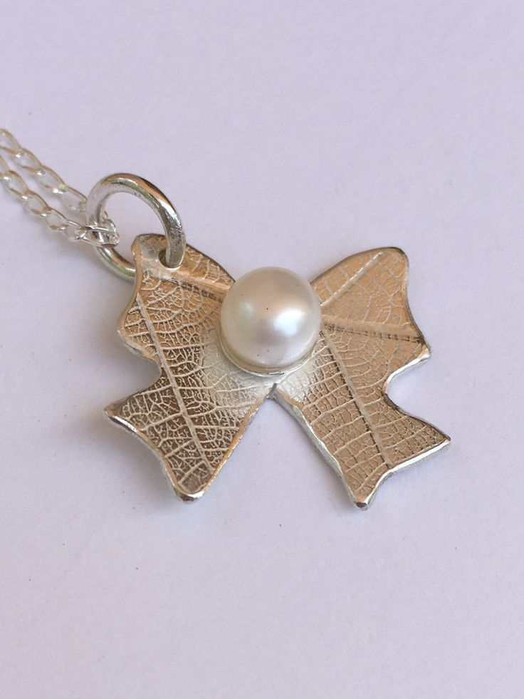 Bow Pendant with freshwater pearl by SilverByKat on Etsy