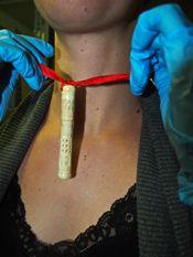 Flea catcher necklace worn around woman's neck