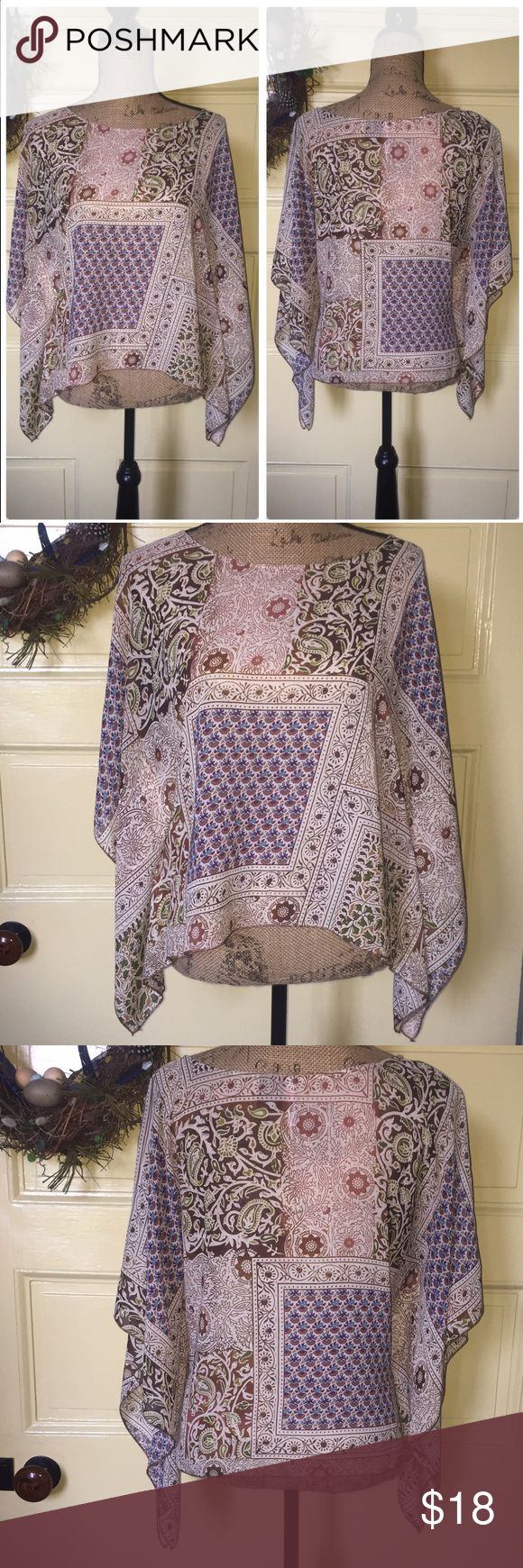 """Fire semi-sheer boho, batwing lightweight top. M Fire semi-sheer boho, batwing lightweight top. Size M. Great boho colors: browns, greens, blues, purple all on cream background. A tank is perfect under this for cool, breezy summer wear.  Lightly worn- looks like new. 100% polyester. Chest (armpit seam to seam) 21"""", Length (shoulder to hem) 22"""" Fire Los Angeles Tops Blouses"""