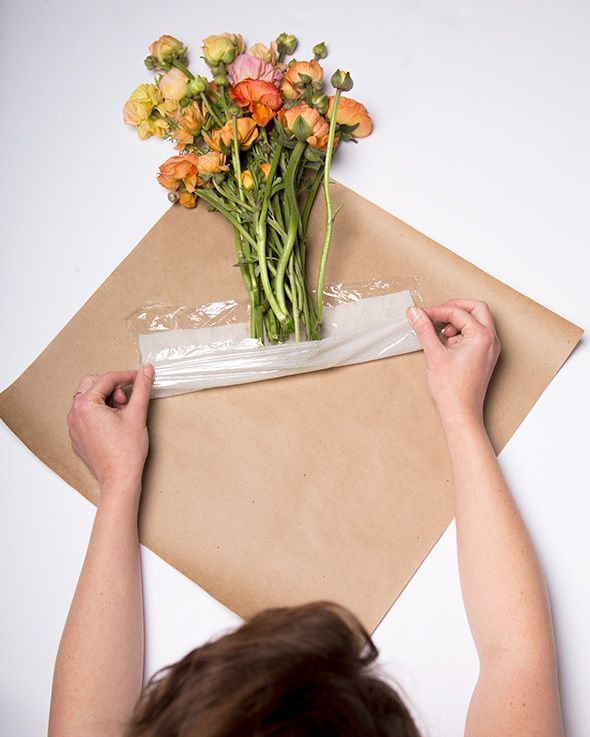 If you're transporting a bundle of flowers a long distance, the easiest way to keep them looking perky is to water them en route. Here, a damp paper towel wrapped in plastic wrap and tucked inside brown paper wrapping will keep them looking healthy. Get the tutorial from Say Yes »   - countryliving.co.uk