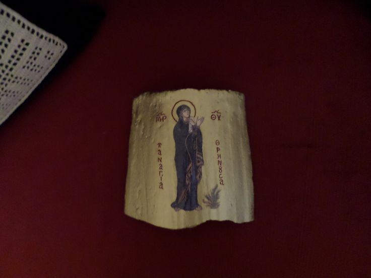 HOLY ICON ON VINTAGE ROOF TILE