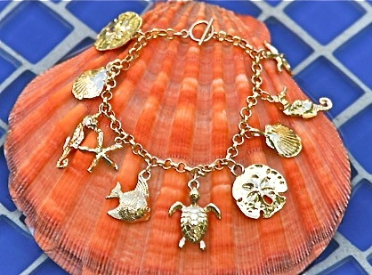 Gold Beachy Charm Bracelet. Now, this is a charm braclet that I'd actually wear.