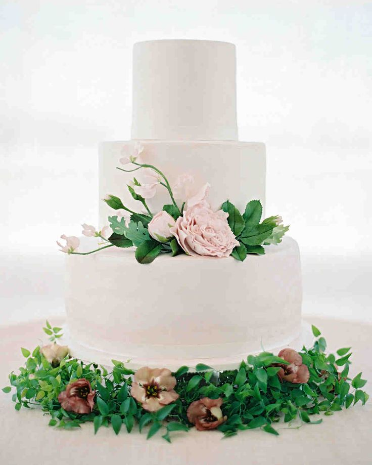 A Peach-and-Pink Garden-Themed Wedding in Brazil   Martha Stewart Weddings - The King Cake created a three-tiered walnut cake with caramel filling, adorned with pink sugar flowers and greenery.
