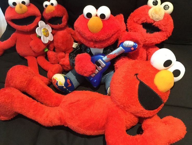 Rock N Roll Elmo- to watch video copy and paste this link into your browser. Rock & Roll Elmo sings and shakes just as he should. Elmo with Flower probs needs new batteries as doesnt light up or talk so is being sold AS IS.   eBay!