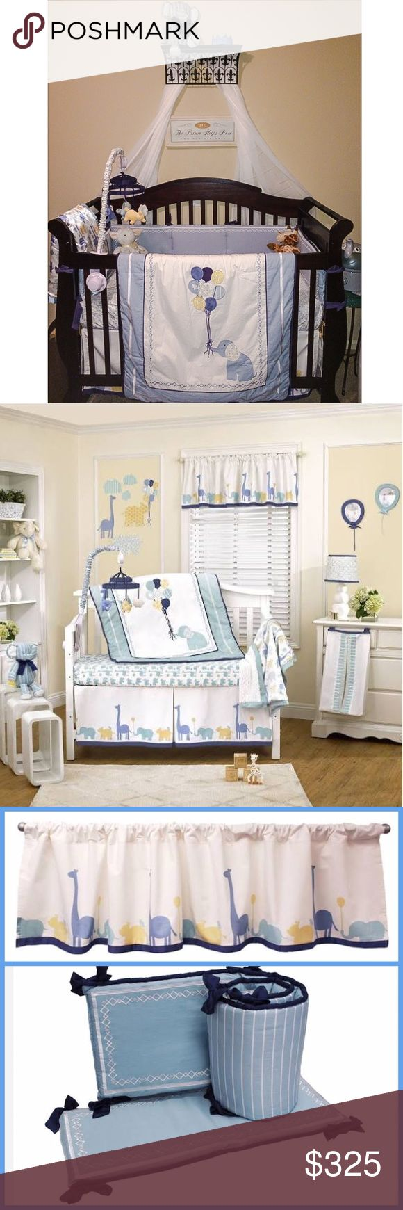 Petit Tresor Happy Animals Nursery bedding &decor The stylish Petit Tresor Happy Animals bedding set & matching decor present a unique combination of traditional & eclectic patterns w/contemporary design elements. Set includes quilt, crib skirt, fitted sheets, bumper, matching balloon frames, plush elephant, mobile, lamp shade & 2 window valances. An arrangement of several shades of blue & crisp white w/accents of navy blue & yellow creates a delightful nursery. Everything is very gently…