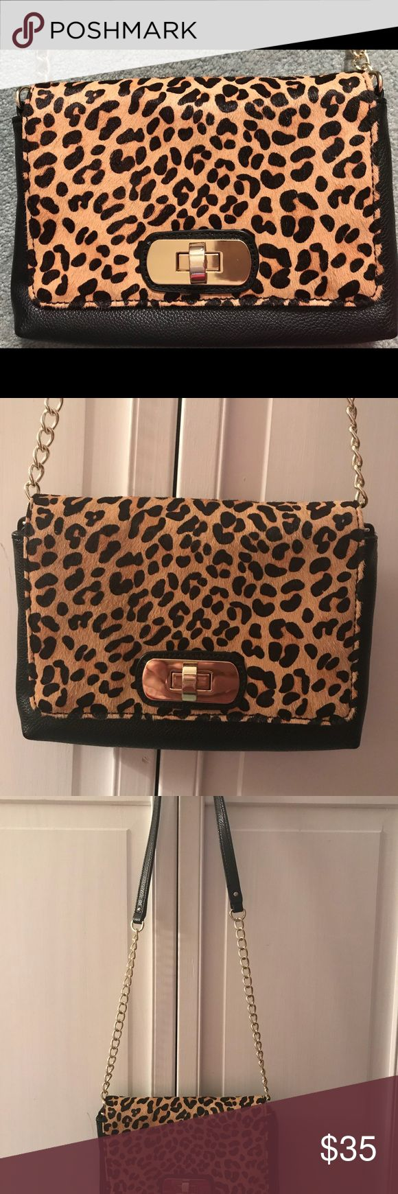 Banana Republic Animal Print Purse Stylish Banana Republic Dyed Calf Hair Purse. Gold chain and faux leather strap. Synthetic Leather. Mint pre-owned condition! Used just once! Bags Crossbody Bags
