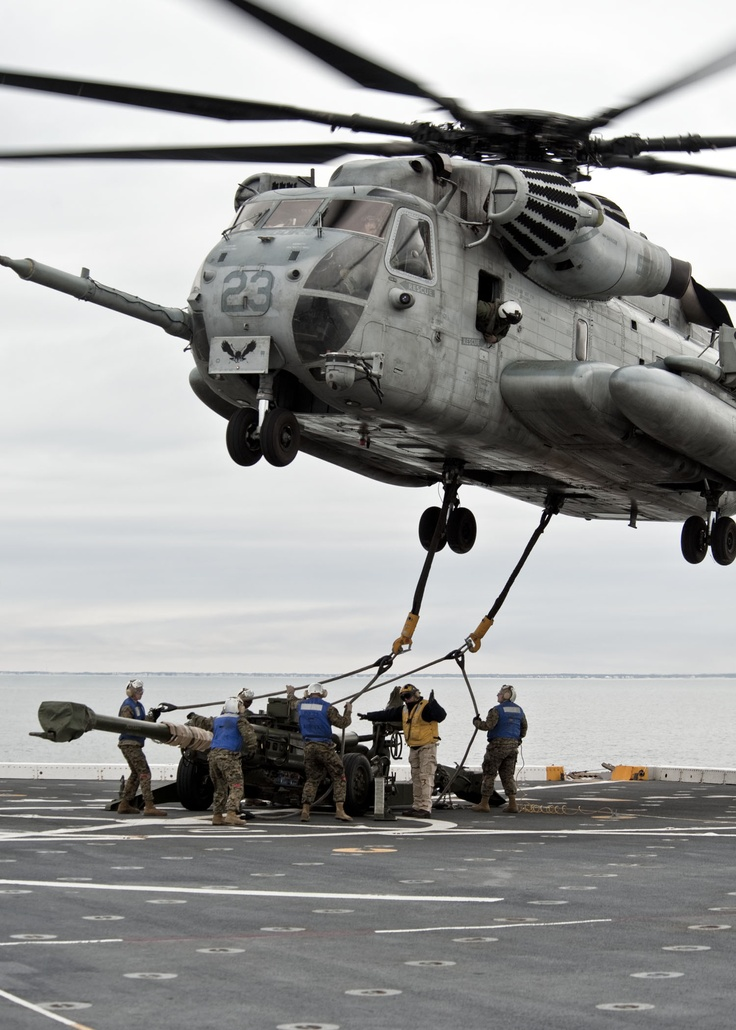 CH-53E Super Stallion from VMM 261, 24th MEU, lifts a M777A2 155mm howitzer off the flight deck of the USS New York.: Flight Decks, Aircraft Military, Military Aircraft, Airplane, Usmc, Helicopters, R Militaryporn, Military Tidbit, Military Aviator