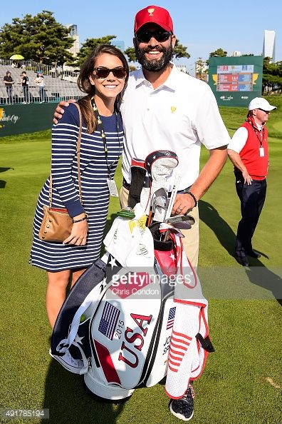 Annie Verret, girlfriend of Jordan Spieth of Team USA, and Spieth's caddie Michael Greller pose for a photo during the first round of The Presidents Cup at Jack Nicklaus Golf Club Korea on October 8, 2015 in Songdo IBD, Incheon City, South Korea.