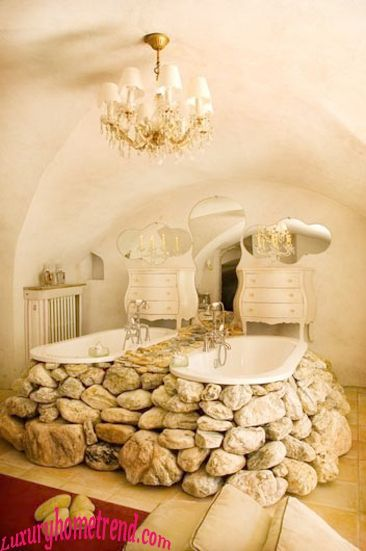 """Natural Stone Bathroom.  This is a novel way to use those rocks on your property (or buy just the right ones).  surround two clawfoot or other kind of tub, remembering to save a space for getting in and out without climbing on the rocks .  Make sure the floor can support the weight.  Add some personal touches and you have a """"bathing system""""."""