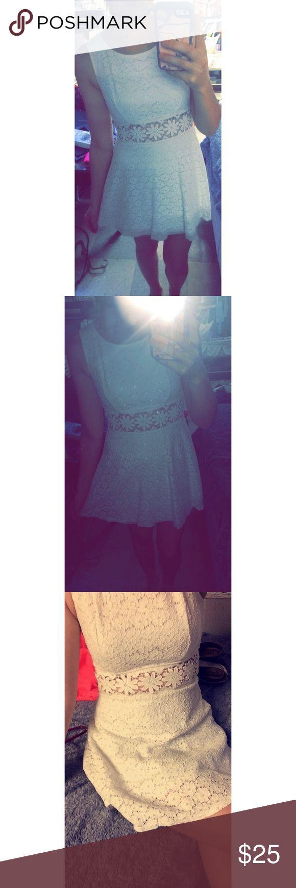 White cutout crochet dress Beautiful crochet dress with cutouts around the waist. Size small. Bought from Deb shops. Like new. Deb Dresses Mini