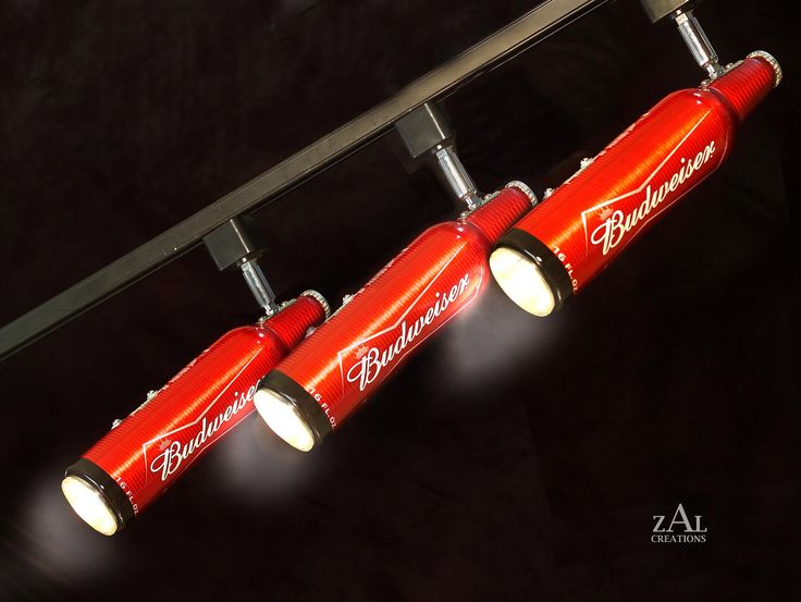 Beer bottles upcycled into Track Lighting Fixture. 3 Track lights & Track.. $265.00, via Etsy.