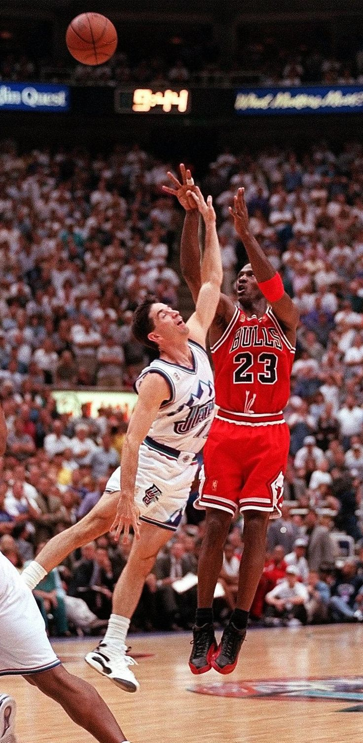 Chicago Bulls Michael Jordan makes his final 3-point shot over the top of Utah Jazz's John Stockton during the fourth quarter of Game 5 of the NBA Finals Wednesday, June 11, 1997, in Salt Lake City. Jordan, suffering from flu symptoms, scored 38 to help the Bulls beat the Jazz 90-88 to take a 3-2 lead in their series. (AP Photo/Douglas C. Pizac)