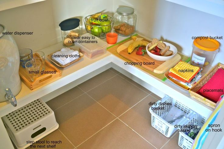 An excellent food preparation area created on the bottom shelf of the pantry at home. Learning to prepare food, clean up messes, and be independent while feeding yourself are amazing steps in Montessori Practical Life.