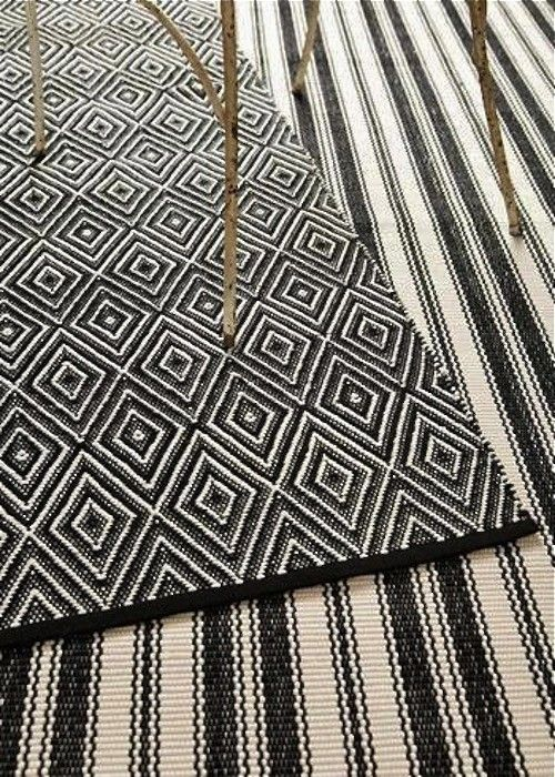 Dash & Albert black ivory outdoor rugs ; Gardenista A Dash & Albert Diamond Rug in black and ivory is available in eight sizes; a 6-by-9-foot rug is $319.