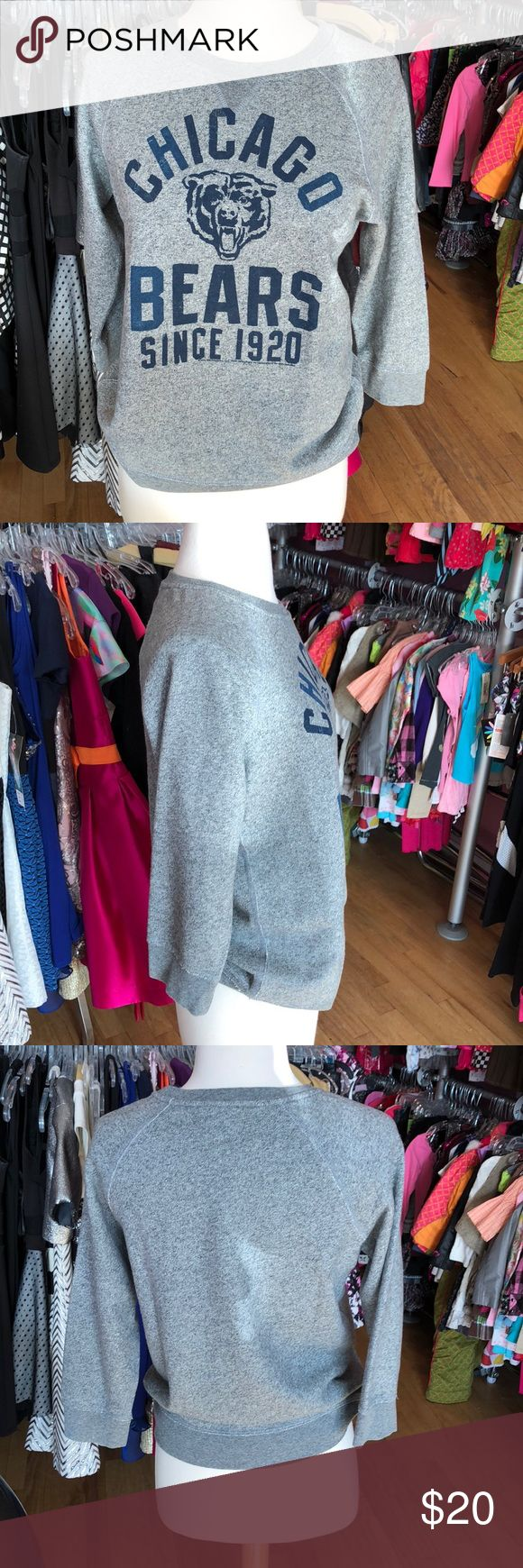 """Junk Food XXL Chicago Bears Sweatshirt Junk Food XXL/14 Chicago Bears Sweatshirt. This grey sweatshirt has a soft cotton material. The """"Chicago Bears since 1920"""" writing is a navy blue color. It's very soft on the inside. Great to lounge in! No signs of wear or pulls. Consigned to my boutique. No trades. Junk Food Tops"""