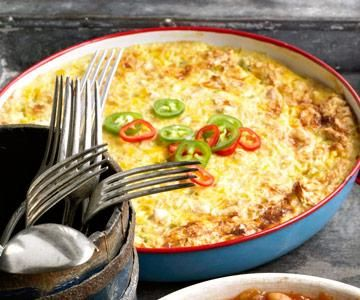 Triangle Ranch Scalloped Corn    Diced green chile peppers give this baked and cheesy dish character with some hotness. We like the crunch from the saltine crackers, too. The recipe comes from Triangle Ranch Bed and Breakfast in western South Dakota, where guests enjoy hearty meals prepared by B owner Lyndy Ireland.