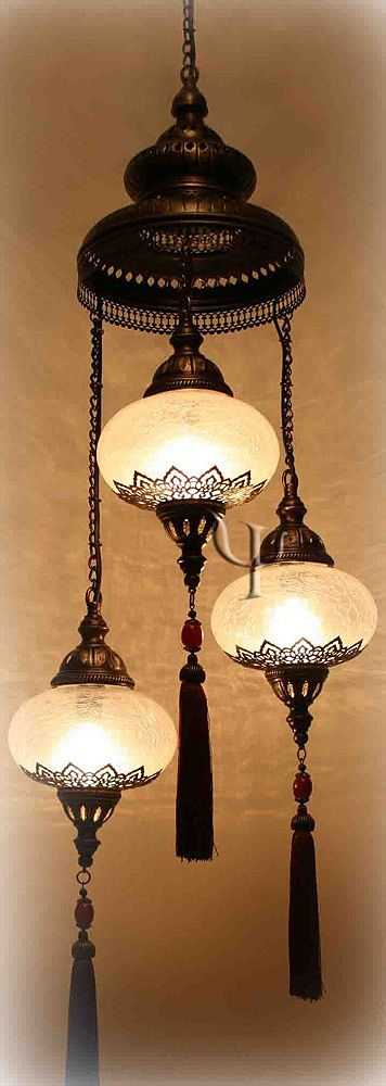 Exotic travels lighting. Could work well in the dining room provided the ceiling height is in scale with the chandelier.