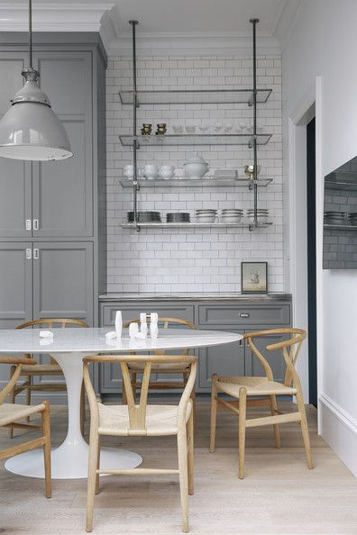 Kill two birds with one stone by installing a sleek shelving unit onto an open wall. Not only will it add more storage space, but it doubles as a display for beautiful pieces of china and servingware.