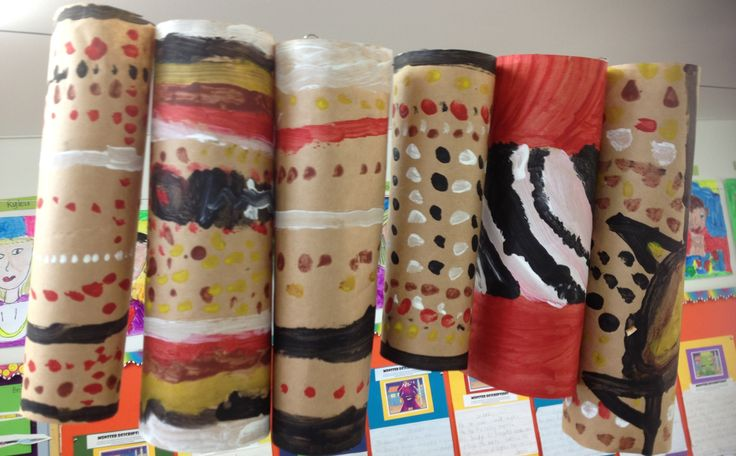 Aboriginal-style painted poles. We painted brown paper, let it dry and then rolled it to make a pole.