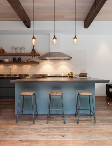 by Rogerseller Combination of recycled timber, stainless steel and concrete bench tops.