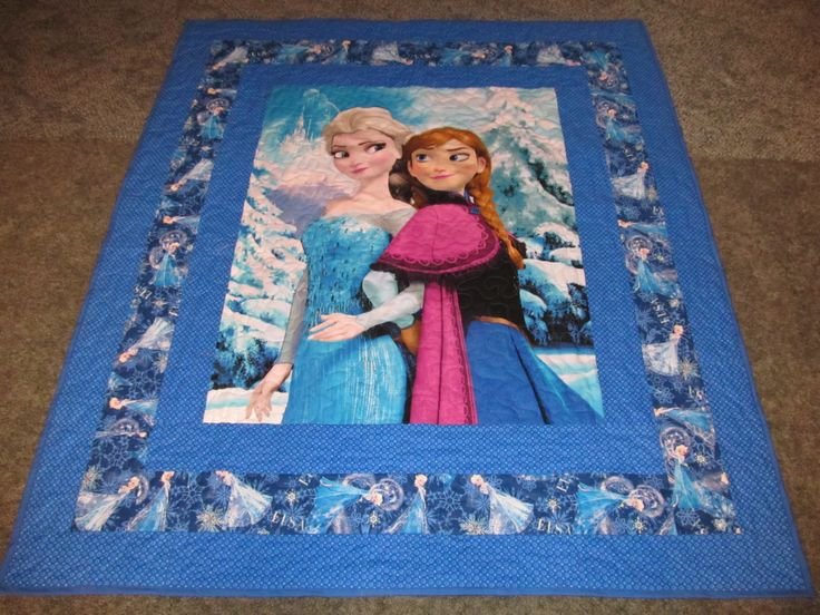 """Frozen Quilt - featuring Elsa on the side - 49"""" X 57"""" - Anna and Elsa in the middle - In Frozen Blue colors. by TheKingsQuiltShop on Etsy"""